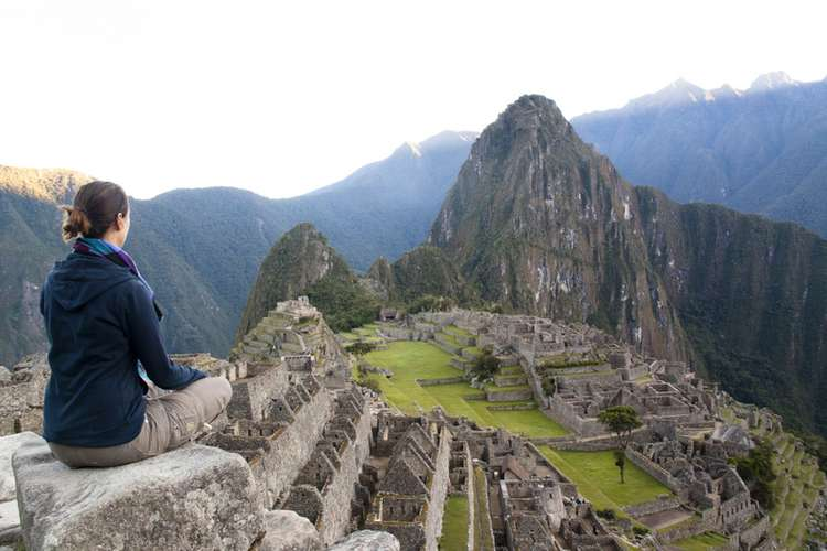 Doing Yoga at Machu Picchu in the Andes Mountains