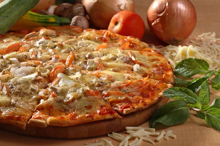 Italian pizza with chicken vegetable toping