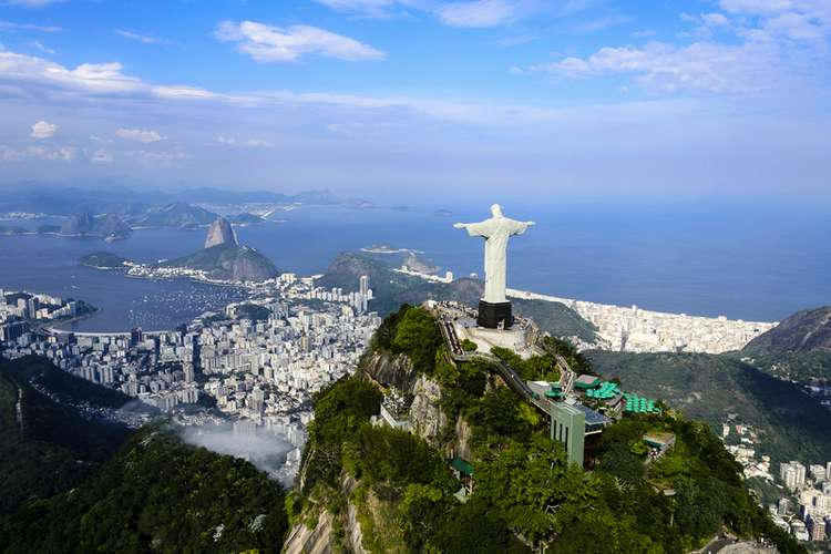 Standing as Christ the Redeemer in Rio de Janeiro