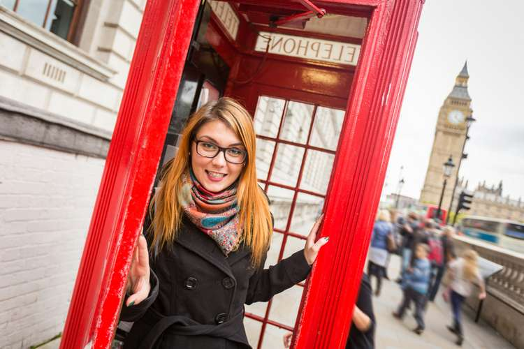 Taking a call in a Telephone Booth in London