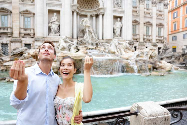 Throwing a coin in The Trevi Fountain in Rome