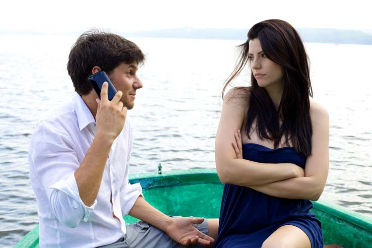 Upset Woman in Boat With Boyfriend