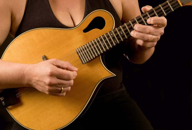Woman playing Mandolin