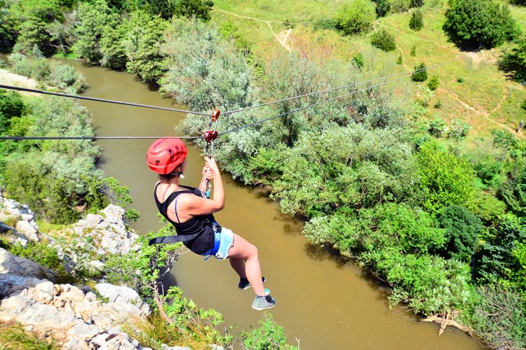 Zip lining over a river