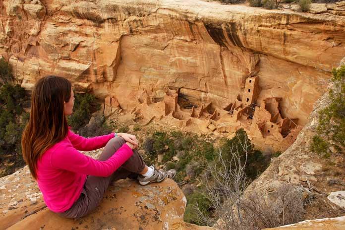 Woman looking at Cliff Palace