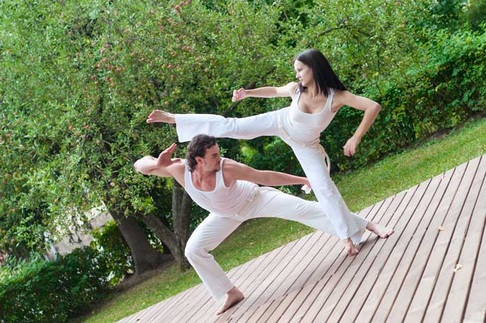 Guy and Girl practicing Capoeira in Brazil
