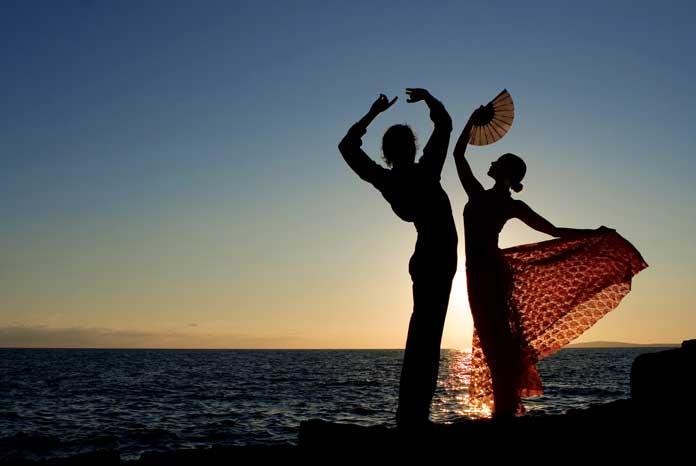 Spanish Flamenco Dancers on the Beach in Spain